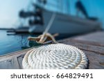 perfectly coiled rope on the... | Shutterstock . vector #664829491