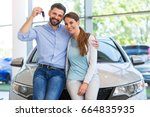 young couple buying a car  | Shutterstock . vector #664835935