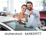 young couple buying a car  | Shutterstock . vector #664835977