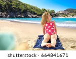 child on beach and summer time    Shutterstock . vector #664841671
