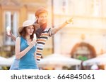 young couple enjoying ice cream ... | Shutterstock . vector #664845061