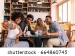 young men and women sitting at... | Shutterstock . vector #664860745