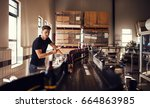 brewer supervising the process... | Shutterstock . vector #664863985