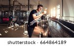 brewery factory owner examining ... | Shutterstock . vector #664864189