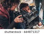 behind the scene. cameraman and ... | Shutterstock . vector #664871317