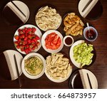 dinner with friends at the... | Shutterstock . vector #664873957