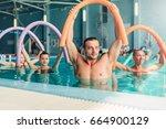 Small photo of Aqua aerobics exercises, women with male trainer