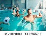women aqua aerobics traninig... | Shutterstock . vector #664900144
