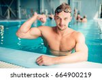 athletic swimmer shows muscles  ... | Shutterstock . vector #664900219
