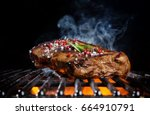 beef steak on the grill grate ... | Shutterstock . vector #664910791
