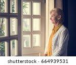 senior woman thoughtful alone... | Shutterstock . vector #664939531