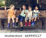 group of kindergarten kids... | Shutterstock . vector #664945117