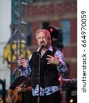 Small photo of DEADWOOD, SD – JUNE 16. Duane Allen of the Oak Ridge Boys performs on Main Street to a crowd of 8,000 fans during the Wild Bill Days in Deadwood, South Dakota – 16 June 2017