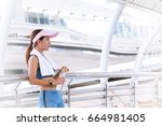 sporty woman in blue dress and... | Shutterstock . vector #664981405