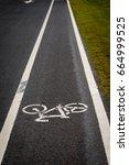 Small photo of bike lane, bicycle lane on asphalt texture background