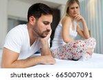 unhappy young couple having... | Shutterstock . vector #665007091