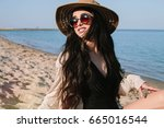 young slim beautiful woman on... | Shutterstock . vector #665016544