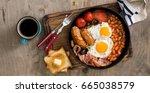 english breakfast on wooden... | Shutterstock . vector #665038579