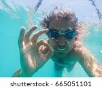 underwater view of man swimming ... | Shutterstock . vector #665051101