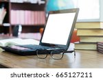 laptop and book on a desk in... | Shutterstock . vector #665127211