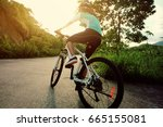 woman cyclist cycling on... | Shutterstock . vector #665155081
