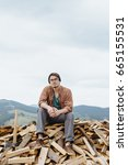 man in hat with ax sitting on... | Shutterstock . vector #665155531