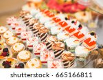 delicious sweets on wedding... | Shutterstock . vector #665166811