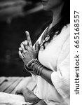woman hands in yoga symbolic... | Shutterstock . vector #665168557