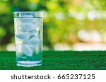 cool water into a glass of ice...   Shutterstock . vector #665237125