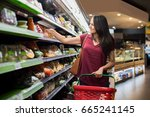 smiling woman doing shopping in ... | Shutterstock . vector #665241145