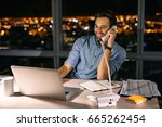 smiling young businessman... | Shutterstock . vector #665262454