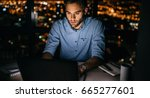 young businessman working on a... | Shutterstock . vector #665277601