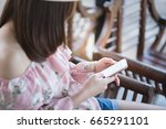 young woman sitting and using... | Shutterstock . vector #665291101