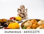 a modak is an indian sweet... | Shutterstock . vector #665312275