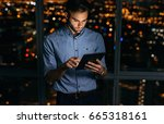 focused young businessman using ... | Shutterstock . vector #665318161