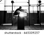 fit young man jumping onto a... | Shutterstock . vector #665339257