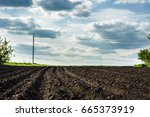 black soil plowed field and... | Shutterstock . vector #665373919