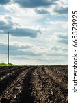 black soil plowed field and... | Shutterstock . vector #665373925