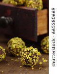 Small photo of Homemade pistachio truffle candies on wooden background