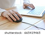 woman using computer mouse with ... | Shutterstock . vector #665419465