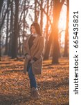beautiful girl walking in park... | Shutterstock . vector #665435821