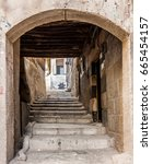 Small photo of Narrow and stones lane in Ancient City of Damascus (Syrian Arab Republic)