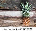 a ripen pineapple on the old... | Shutterstock . vector #665496379