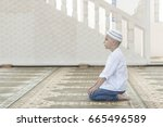 adorable boy is praying in the... | Shutterstock . vector #665496589