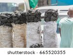 Small photo of Bag of charcoal cut from trees in sub-saharan african country of Zambia