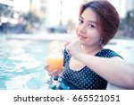 young woman with cocktail in... | Shutterstock . vector #665521051