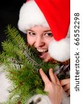 Happy girl in santa hat over blurred illuminated background - stock photo