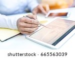 accounting on a tablet computer ... | Shutterstock . vector #665563039