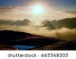 distant mountain range and... | Shutterstock . vector #665568505