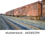 old rusty train wagons on railway - stock photo